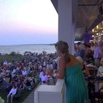View from dining deck overlooks audience gathering for the Thursday evening seaside concert