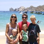 Son & family on beach in front of Los Arcos