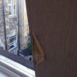 More peeling damp wallpaper