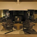 Visit your friends and colleagues around the fireplace in our main lobby