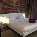 Bed with exposed brick wall