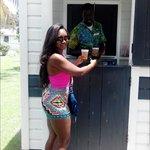 having Carib at the beach bar