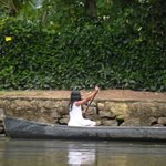 A child using country boat to roam around