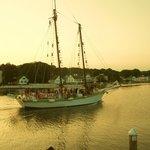 schooner sailing by restaurant at dinner