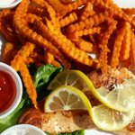Grilled salmon with sweet potato fries.
