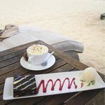 Coffee creme brûlée and brownie with ice cream, by the beach. Perfection