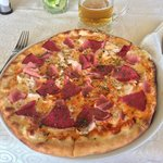 Salami, ham and chicken pizza.