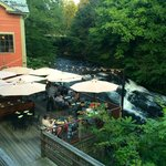Outdoor seating at the Alvah Stone, next to the Sawmill River.