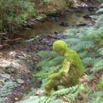 Green man by the stream at Wellstone Cottages