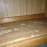 Inside of kitchenette cabinets