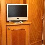 TV above mini-bar and tea/coffee facilities in sitting area