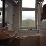 Suite 201 bathroom, large tub and windows
