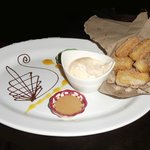 Churros, served with ice cream plus a bit of chocolate sauce and cajeta