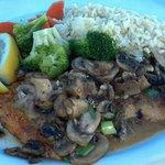 Calamari steak with mushrooms, rice pilaf, steamed vegetables.