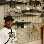 El Nino standing next to his favorite Call Of Duty gun