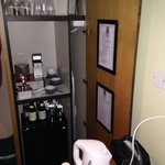 Lovely closet with fridge, kettle, loose tea, and espresso maker.