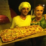 "pizza pala with our friend from ""principe del pacifico"""
