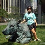 my daughter at the very cool cow statues in financial district