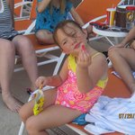 granddaughter Meris resting around the pool
