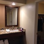 Dressing area with walk in closet in Adobe room