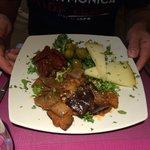 Caponata con formaggi olive e pomodori secchi