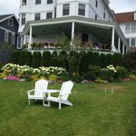 The wonderful front yard with the adirondack chairs.