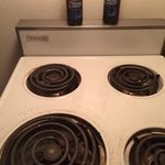 stove top with bud light salt and pepper shakers