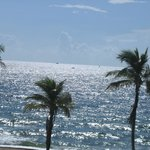 """The beach at high noon"""" as seen from our front window of room on 3rd floor."""