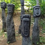 representations of the past heads of the tribe. they sit on a hill, overlooking the ocean.