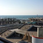Side wiew of  the beach from balcony across a wide concrete plaza