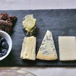 Cheese plate with gluten-free bread blueberries candied pecans and honey cone taster