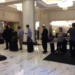Queue to check in or speak to anyone at the hotel lobby