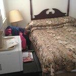 Bed and mini fridge