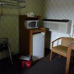 Closet and fridge area of room