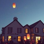 Sky lanterns released by guests over the Dingle waterfront at Milltown House...