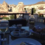 A spectacular view along with wine, bread and amazing hummus plate at the Stone House Cave Hotel