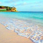 Blue water and light pink sand