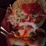 Shrimp fajita taco and fish taco covered with slaw