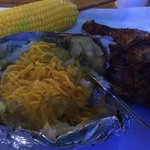 Roasted chicken, baked potato and buttered corn