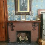 Historic portrait and fireplace.