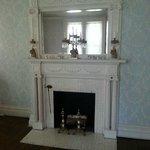 Main parlor, beautiful fireplace.