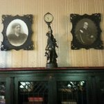 Historic portraits and bookcases.