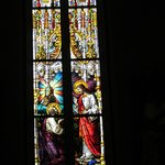One of the vibrantly colored stained glass windows