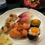 wasabi tobiko with quail egg gunkan, chopped scallop with quail egg gunkan, salmon belly sushi,