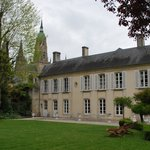 The Hotel Tardif and its peaceful yard with the Bayeux Cathedral in the background