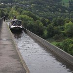 Watch the canal boats cross the aqueduct