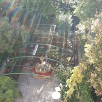 View from the room's balcony looking down on the garden