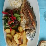Seabream with vegetables and french fries.