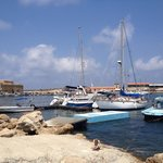 Boats in Paphos harbour with castle in background.
