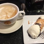 Latte & cannoli with ricotta filling. so good!!
